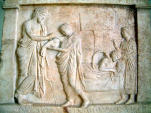 Stele from Oropos (near Athens) showing a healing hero (Amphiaros) healing a patient. Fourth century BCE. Image courtesy of www.HolyLandPhotos.org