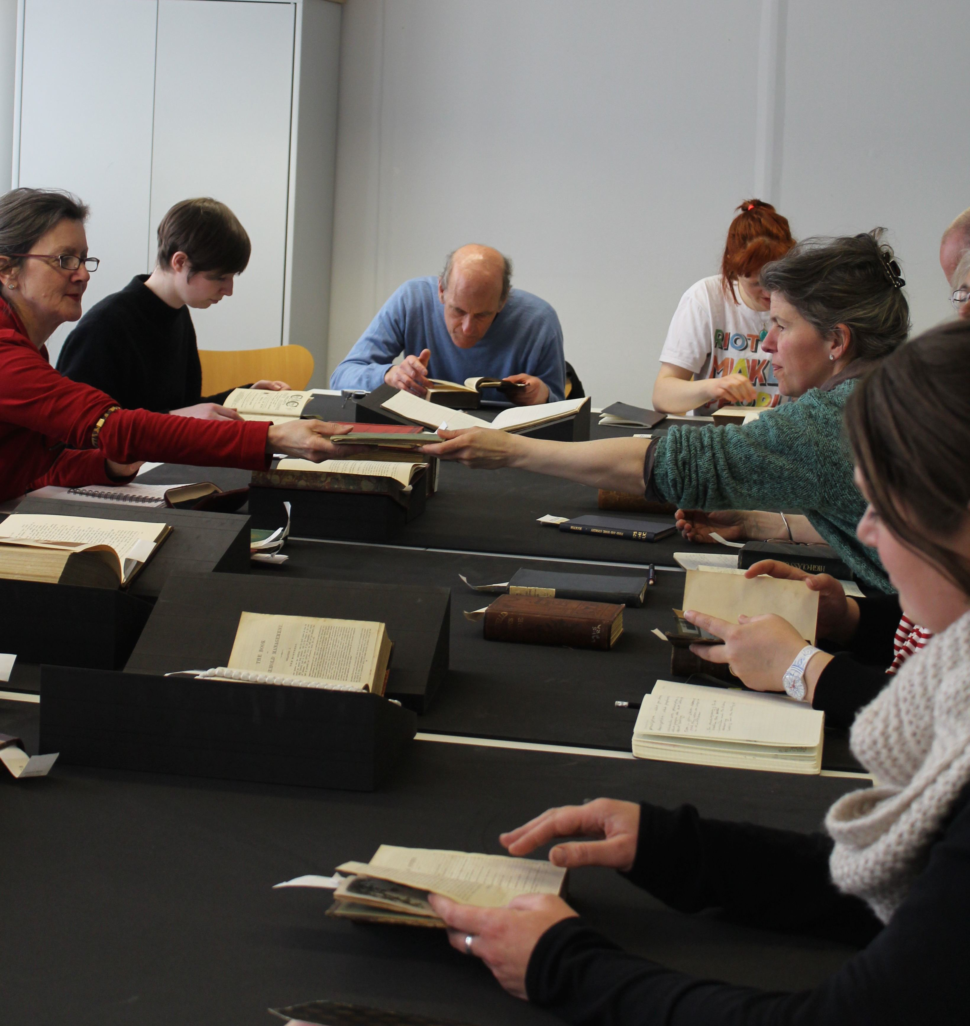 Participants engaging with a wide range of nineteenth-century cookbooks held at the Manchester Metropolitan University Special Collections. Photo Credit: FEAST online journal.